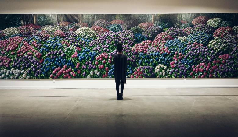 Devanga, 19, embracing a vivid work of art.